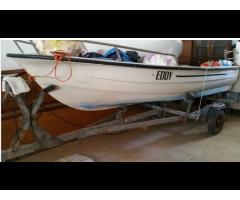Barca con motore e carrello